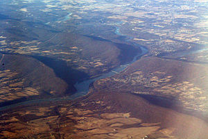 Potomac River - The Potomac River flowing through water gaps in the Blue Ridge Mountains near Harpers Ferry, West Virginia. Virginia is on the left, Maryland on the right, West Virginia in the upper right.