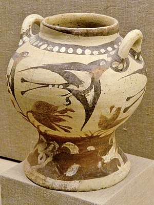 Museum of Prehistoric Thera - Ceramic pitcher with swallows from Akrotiri, 1700 BC. Museum of Prehistoric Thira