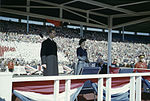 Princess Elizabeth on stage with Prince Philip, Duke of Edinburgh in front of large audience. Royal Visit 1951, Ontario.jpg