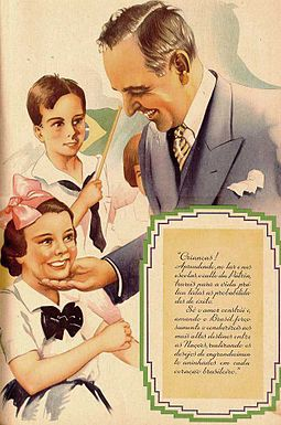 "A 1938 propaganda of the New State depicting Brazilian President Getulio Vargas flanked by children. The text reads ""Children! Learning, at home and in school, the cult of the Fatherland, you will bring all chances of success to life. Only love builds and, strongly loving Brazil, you will lead it to the greatest of destinies among Nations, fulfilling the desires of exaltation nestled in every Brazilian heart."" Propaganda do Estado Novo (Brasil).jpg"