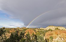 This image has an empty alt attribute; its file name is 220px-Rainbow_in_badlands_Theodore_Roosevelt_NP_ND1.jpg