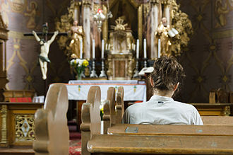 Christian prayer - Woman praying in a church