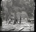 Rebuilding of the bridge over the Virgin River at Birch Creek, near Court of the Patriarchs. ; ZION Museum and Archives Image (6ca11c12602448dc8859fc8b2b35cccb).tif