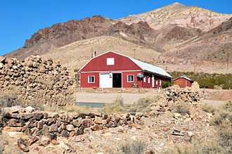 Goldwell Open Air Museum - The Red Barn sits amid the Bullfrog ruins at the base of Bonanza Mountain