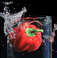 Red pepper falls into glass of water.jpg