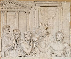 Roman art -  Preparation of an animal sacrifice; marble, fragment of an architectural relief, first quarter of the 2nd century CE; from Rome, Italy
