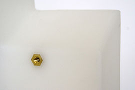 A brass threaded hex insert can be molded into plastic parts.