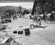 Royal Engineers prepare to blow up a bridge in Malaya