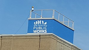 San Francisco Department of Public Works - Logo of San Francisco Public Works on the top of a building in San Francisco.