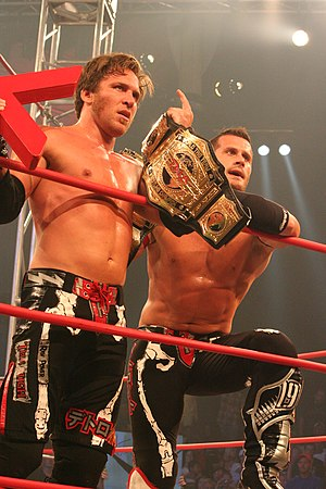 The Motor City Machine Guns - Sabin and Shelley holding the TNA World Tag Team Championship belts, after defeating Beer Money, Inc. in an Ultimate X match