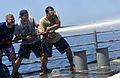 Sailors man a fire hose in the Arabian Gulf. (9153294402).jpg