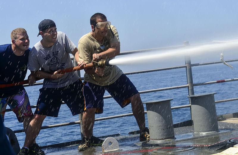 File:Sailors man a fire hose in the Arabian Gulf. (9153294402).jpg