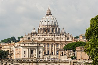 St. Peter's Basilica in Vatican City, the papal enclave within the Italian city of Rome, one of the largest religious tourism sites in the world Saint Peter's Basilica facade, Rome, Italy.jpg