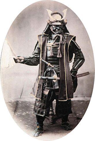 Military tradition - A traditional samurai warrior, circa 1860. Photograph by Felice Beato