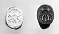 Scarab seal with Bes dominating two lions below a winged sun disc MET ss41 160 163.jpg