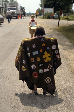 Scouting memorabilia collecting - A collection of Scout badges, attached to a poncho, seen at the Fourth Pentathlon Jamboree in Fredericton, New Brunswick, 1986