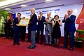 Secretary Kerry Applauds as Former U.S. Senator Kerrey is Presented With the New Fulbright University Vietnam's School License at a Ceremony in Ho Chi Minh City (26668081164).jpg