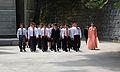 Severokorejší turisté odcházejí z Frienship muzea - panoramio.jpg