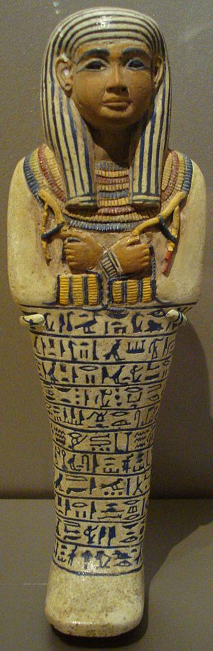Egyptian faience - Egyptian faience ushabti of Lady Sati. New Kingdom, Dynasty XVIII, reign of Amenhotep III, c. 1390-1352 BC. Possibly from Saqqara.