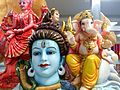Shiva Parvati Ganesha Images - A statuette representing Lord Ganesh and his father Lord Shiva.jpg