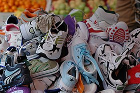 3aef572f312 A large pile of high-quality athletic shoes for sale at a market in Hong  Kong