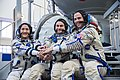 Soyuz MS-12 crew in front of the Soyuz spacecraft simulator.jpg