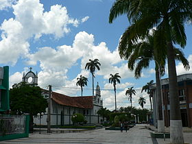 Part of the main square and the church of Cobija