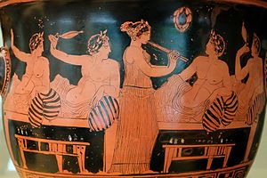 Symposium - A female aulos-player entertains men at a symposium on this Attic red-figure bell-krater, c. 420 BC