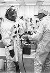 Technician Clyde Teague checks spacesuit of Apollo 9 commander James A. McDivitt prior to scheduled launch into earth orbit with David R. Scott and Russell L. Schweickart.jpg