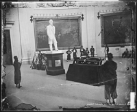 Thaddeus Stevens lying in state on August 13, 1868. The plaster statue of Abraham Lincoln behind the casket is credited to Henry Jackson Ellicott.
