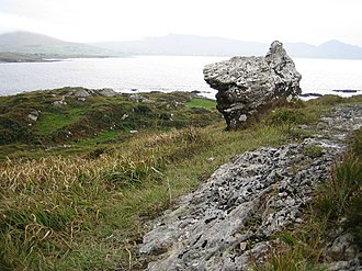 The Hag of Beara - The Cailleach Beara, or Hag of Beara. According to legend, this rock represents the fossilized remains of the face of the Cailleach Beara, staring out at the ocean and awaiting her husband Manannán, God of the Sea, to return to her
