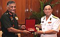 The Chief of Army Staff, General V.K. Singh presenting a memento to the Deputy Minister and Commander-in-Chief of the Vietnam People's Navy, Vice Admiral Nguyen Van Hien, in New Delhi on June 28, 2011.jpg