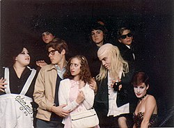 Young fans of The Rocky Horror Picture Show posing, dressed in home-made costumes