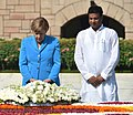 The German Chancellor, Dr. Angela Merkel paying homage at the Samadhi of Mahatma Gandhi, at Rajghat, in Delhi on October 05, 2015.jpg