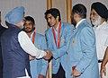 The Prime Minister, Dr. Manmohan Singh meeting with the Beijing Olympic bronze medal winners, wrestler Sushil Kumar and boxer Vijender Kumar, in New Delhi on August 26, 2008.jpg