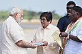 The Prime Minister, Shri Narendra Modi being received by the Lieutenant Governor of Puducherry, Dr. Kiran Bedi and the Chief Minister of Puducherry Shri V. Narayanasamy, on his arrival, in Puducherry on February 25, 2018.jpg