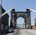 The eastern, or downtown-Wheeling arched entryway to the Wheeling Suspension Bridge, also known as the Stone Arch Bridge, which was the largest suspension bridge in the world from 1849 until 1851. LCCN2015632043.tif