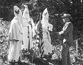 Three Klansmen talking to PI reporter Robert Berman, circa 1923 (MOHAI 15411).jpg