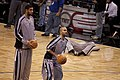 Tim Duncan and Tony Parker holding balls Spurs-Magic043.jpg