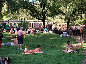 Tompkins Square Park - People relaxing and sunbathing on the park's central knoll