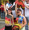 Topless body-painted female football fans at World Cup in Germany-24June2006.jpg