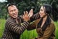 Traditional javanese couple jokes in the paddy field.jpg