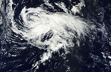 Nadine is rather disorganized, with ragged banding features and a partly exposed center of circulation.