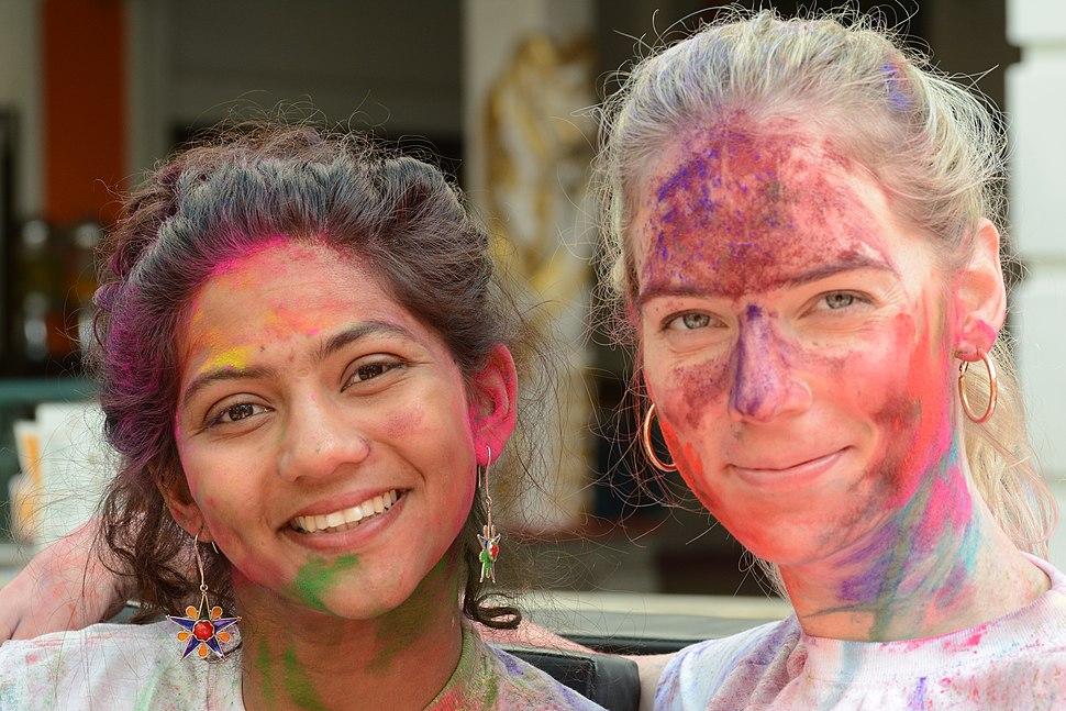 Two women celebrating Holi