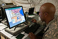 U.S. Army Sgt. 1st Class Chester Shaw, a sustainment sergeant with the U.S. Army Europe Contingency Command Post, works on creating digital overlays that help identify possible routes in Pabrade, Lithuania 130606-A-HW973-001.jpg