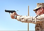 U.S. Marine Corps Capt. Jeremy Nelson, with Regional Command Southwest, fires an M9 pistol Oct. 3, 2013, during a weapons marksmanship course at Camp Leatherneck, Afghanistan 131003-M-DE426-005.jpg