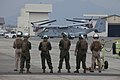 U.S. Marines with Marine Medium Helicopter Squadron (HMM) 262 await the arrival of 12 MV-22 Osprey tiltrotor aircraft July 30, 2013, on the flight line at Marine Corps Air Station Iwakuni, Japan 130730-M-YH418-017.jpg