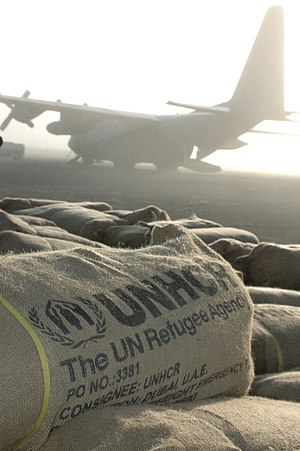 United Nations High Commissioner for Refugees - UNHCR packages containing tents, tarps, and mosquito netting sit in a field in Dadaab, Kenya, on 11 December 2006, following disastrous flooding
