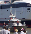 USCG patrol boat escorting the Spirit of Ontario I Fast Ferry 2004-08-08.png