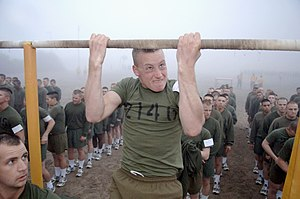 United States Marine Corps Physical Fitness Test - A Marine performs pull-ups